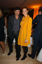 YASMIN LE BON and GERRY DE VEAUX at a Burns Night dinner in aid of CLIC Sargent and Children's Hospice Association Scotland held at St.Martin's Lane Hotel, St.Martin's Lane, London on 25th January 2007.<br />