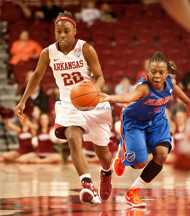 Jan 29, 2012; Fayetteville, AR, USA; Florida Gators guard Lanita Bartley (3) attempts to steal the ball from Arkansas Razorbacks guard C'eira Ricketts (22) during a game at Bud Walton Arena. Arkansas defeated Florida 73-72 in the second overtime. Mandatory Credit: Beth Hall-US PRESSWIRE