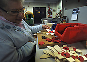 © Licensed to London News Pictures. 07/11/2011. Richmond, UK.Gillian and Ian Lyndsay, married, have both worked at the factory for 25 years. Red Poppies being made in The Poppy Factory in preparation for sale in 2012, Richmond, Surrey today 7th November.  The factory has been supplying the poppy, crosses and wreathes to the British Legion for almost 90 years. It is staffed by veterans, many whom of which are injured, sick or wounded of all ages. Photo credit : Stephen Simpson/LNP