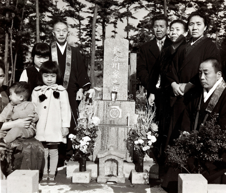 group posing at the family grave Japan late 1950s