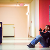 012413       Cable Hoover<br /> <br /> Business technologies student Jason Frank sits alone in a hallway at UNM-G in Gallup Thursday.
