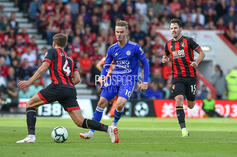 Leicester City Midfielder, James Maddison (10) beats AFC Bournemouth Midfielder, Dan Gosling (4) and AFC Bournemouth Defender, Adam Smith (15) to the ball during the Premier League match between Bournemouth and Leicester City at the Vitality Stadium, Bournemouth, England on 15 September 2018.