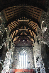 Interior of the medieval church, Iona Abbey..Iona is a small island in the Inner Hebrides off the western coast of Scotland. It was a centre of Irish monasticism for four centuries and is today renowned for its tranquility and natural beauty..©Michael Schofield..