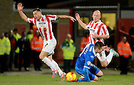 Jed Wallace is fouled by Lee Vaughan during the Sky Bet League 2 match between Cheltenham Town and Portsmouth at Whaddon Road, Cheltenham, England on 20 December 2014. Photo by Alan Franklin.