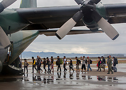 26/11/2013.  Residents of the city of Tacloban in the Philippines are still evacuating more than 2 weeks after a super typhoon destroyed the city.  Military C130 aircraft are working 24 hours a day until further notice as the aid effort contines.  Photo credit: Alison Baskerville/LNP