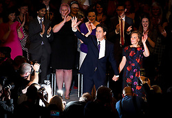 © London News Pictures. 24/09/2013 . Brighton, UK.  Labour party leader ED MILIBAND and wife JUSTINE THORNTON wave to the crowd on stage after ED MILIBAND delivered his Key-note speech on the third day of the Labour Party Conference in Brighton. Photo credit : Ben Cawthra/LNP