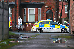 © Licensed to London News Pictures. 29/12/2020. Manchester, UK. Scene where three people were found dead in unexplained circumstances last night (28th December 2020) at a house on Oldham Road in Failsworth, North East Manchester. Photo credit: Joel Goodman/LNP