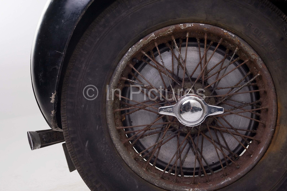 Found in a garage where it had been stored virtually untouched for 50 years, this 1937 Bugatti Type 57s Atalante sports car is previewed for the first time before a Bonhams auction in Paris on February 7th 2009. Here, we see a detail of the rusty spoked wheels in a garage/studio before the auction and sale in Paris. In 2008 the Bugatti Type 57S with chassis number 57502 built in 1937 with the Atalante coachwork for Earl Howe was discovered in a private garage in Newcastle upon Tyne, having been stored untouched for 48 years and known about only by a select few people. It was auctioned in February 2009 at the Retromobile motor show in Paris, France, fetching €3.4 million (US$4.6 million), becoming one of the highest valued cars in automotive history, owing much to its extremely low mileage, original condition and ownership pedigree.