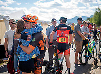 J. Trevor Robinson, of Jackson, gets a hug upon finishing the LoToJa Classic on Saturday in Teton Village. Robinson was the top local finisher, posting a time of 08:51:29 for eighth place.