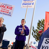 031015       Cable Hoover<br /> <br /> DeeAnn Leyba, left, Jeremiah Salaz and Inez Giron campaign for mayoral and city council candidates outside the polling station at the south fire station in Gallup Tuesday.