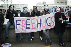 © Licensed to London News Pictures. 30/11/2011. London, UK. Member of the Occupy London Stock Exchange group watch watch the public sector march from Embankment, London.  Workers and Union members take part in a national public sector worker strike in central London today (30/11/2011). Up to two million public sector workers are staging a strike over pensions in what is set to be the biggest walkout for a generation.  Ben Cawthra/LNP