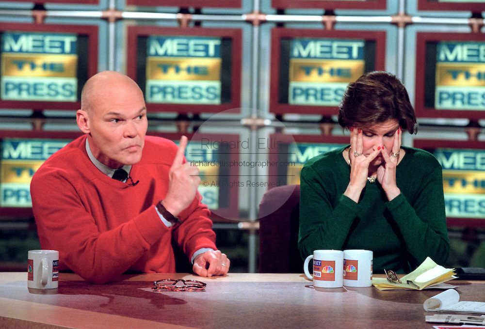 Democratic activist James Carville attacks the Republican Congress for impeaching President Clinton as his wife conservative commentator Mary Matalin hands her head during NBC's Meet the Press December 20, 1998 in Washington, DC.