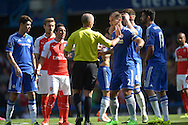 Referee Michael  Dean talking to Branislav Ivanovic, the Chelsea standing captain while trying to calm the situation. Barclays Premier League match, Chelsea v Arsenal at Stamford Bridge in London on Saturday 19th September 2015.<br /> pic by John Patrick Fletcher, Andrew Orchard sports photography.