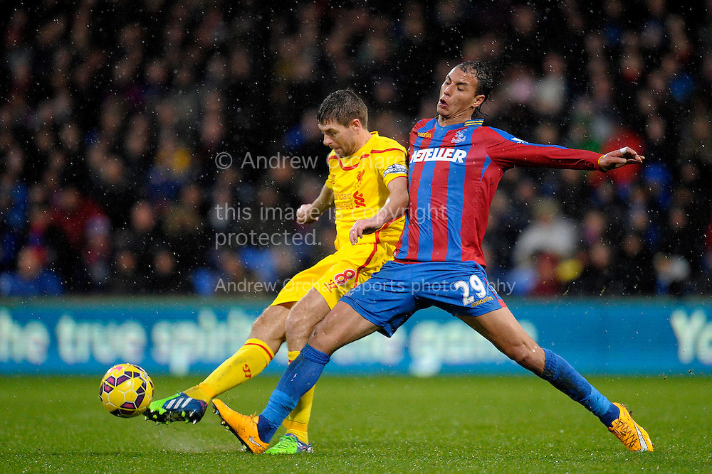 Marouane Chamakh of Crystal Palace challenges Steven Gerrard of Liverpool. Barclays Premier league match, Crystal Palace v Liverpool at Selhurst Park in London on Sunday 23rd November 2014.<br /> pic by John Patrick Fletcher, Andrew Orchard sports photography.