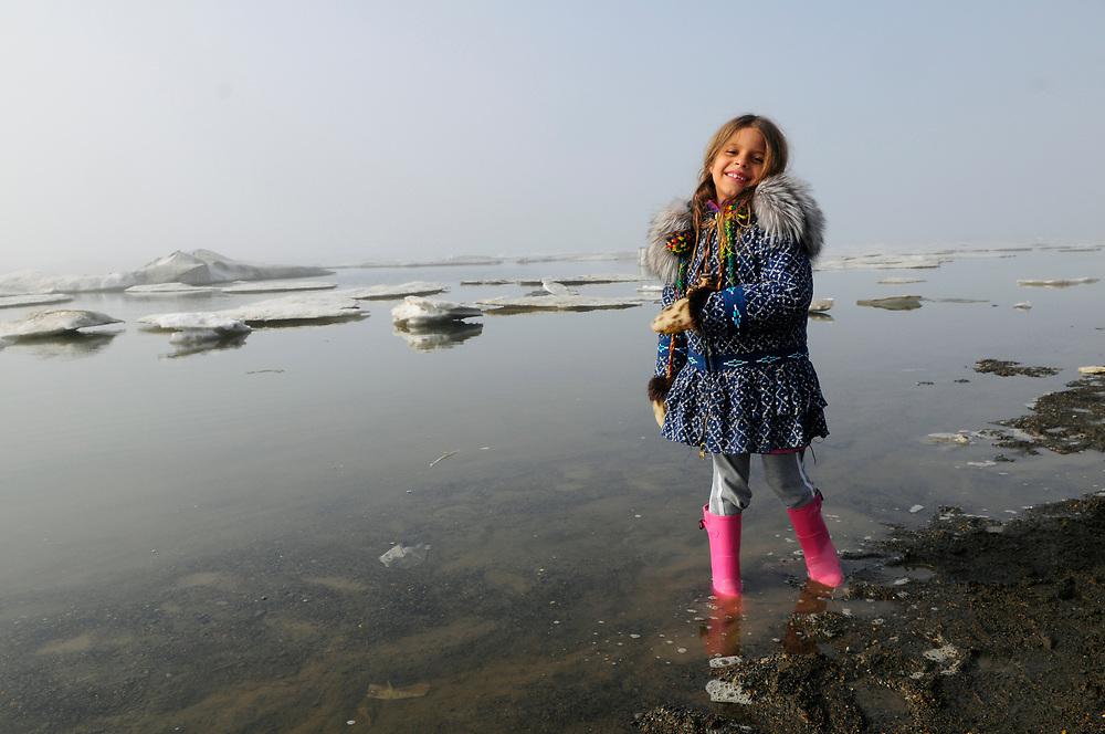 Barrow, Alaska, June 26th, 2008. Kids playing at the beach by the Arctic Ocean. Summer. Juliana Whitaker Aikins. MR