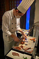 Beijing , China - September 23, 2014: cooks chefs preparing traditional Chinese Roast Duck cooking at tha famous Dadong restaurant Beijing China