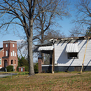 COLUMBIA, SOUTH CAROLINA - JANUARY 27: An abandoned home is seen near a church in the Booker T. Washington neighborhood in North Columbia, SC on January 27, 2020.  The Booker T. Washington neighborhood is considered one of the most improverished neighborhoods in Columbia.   (Photo by Logan CyrusforThe Washington Post)