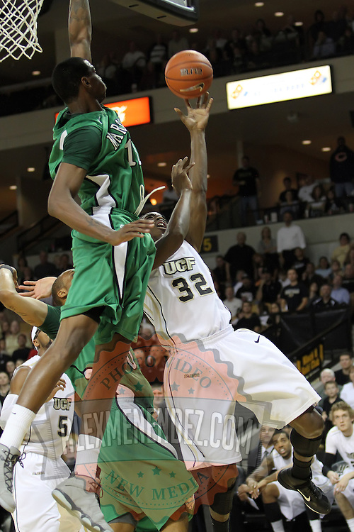 Central Florida guard/forward Isaiah Sykes (32) shoots during a Conference USA NCAA basketball game between the Marshall Thundering Herd and the Central Florida Knights at the UCF Arena on January 5, 2011 in Orlando, Florida. Central Florida won the game 65-58 and extended their record to 14-0.  (AP Photo/Alex Menendez)