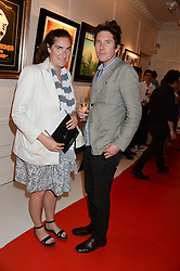 REBECCA GUINNESS and CHRIS TAYLOR at Ronnie Wood's Raw Instinct Summer Party held at Castle Fine Art, Bruton Street, London on 9th July 2013.