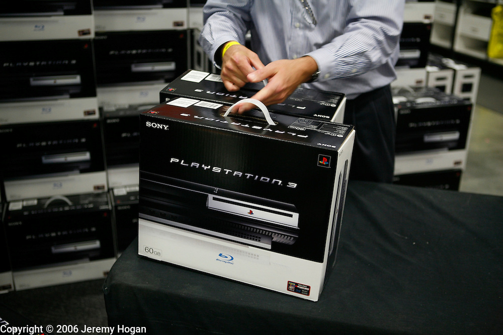 Best Buy employee Pat McCann, moves one of the 190 PS3 video games consoles that went on sale at 12:01 a.m.
