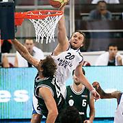 Anadolu Efes's Dusko SAVANOVIC (C) during their Turkish Basketball League match Anadolu Efes between Aliaga Petkim at Aliaga Arena in Istanbul, Turkey, Sunday, October 23, 2011. Photo by TURKPIX