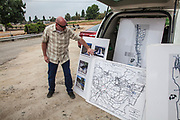 Senior Hydrogeologist points to a map of the San Gabriel Spreading Grounds, San Gabriel Spreading Grounds, Water Replenishment District – WRD, Pico Rivera, Los Angeles County