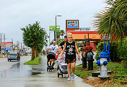 Visiting from Scotland, Stephanie Sanderson Photo by front), her husband Greg Ritchie, Photo by behind Stepanie) and Alex Hardie walk with their families down a nearly deserted International Drive in Orlando, FL, USA. on Sunday, September 10, 2017 as wind and rain from Hurricane Irma arrives in Central Florida. Photo by Jacob Langston/Orlando Sentinel/TNS/ABACAPRESS.COM