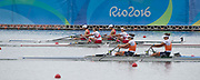"""Rio de Janeiro. BRAZIL. Gold Medalist NED LW2X. Bow. Ilse PAULIS, and Maaike<br /> HEAD, after winning the final, supporters swim out to greet and congratulate the double. 2016  2016 Olympic Rowing Regatta. Lagoa Stadium,<br /> Copacabana,  """"Olympic Summer Games""""<br /> Rodrigo de Freitas Lagoon, Lagoa. Local Time 10:39:01  Friday  12/08/2016 <br /> [Mandatory Credit; Peter SPURRIER/Intersport Images]"""