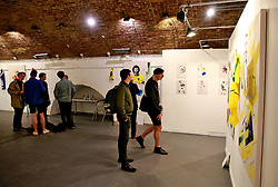 Members of the public view the Art of Football World In Colour Exhibition Preview at Hoxton Arches, London.
