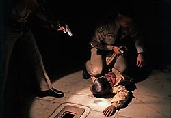 SAN DIEGO, CA - Police arrest a man at gunpoint. (PHOTO © JOCK FISTICK)