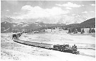 """RGS #42 has just come through the Lizard Head snowshed with a southbound freight.<br /> RGS  Lizard Head, CO  Taken by Jackson, Richard B. - 7/7/1939<br /> In book """"Rio Grande Southern II, The: An Ultimate Pictorial Study"""" page 278<br /> Also at RDS059-010.  Also found on p. 67 of Dorman's """"Southern, The: A Narrow Gauge Odyssey""""; """"RGS Story Vol. IV"""", pp. 268-269 and """"Sunset on the RGS Vol. 2"""", p. 82.<br /> Thanks to Don Bergman for additional information."""