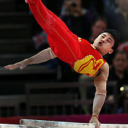 Zhe Feng, China, Gold Medal winner in the Men's Parallel Bars Final in action at North Greenwich Arena during the London 2012 Olympic games London, UK. 7th August 2012. Photo Tim Clayton