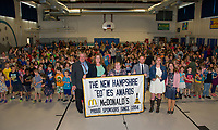 Larry Johnston McDonalds, Jessica Richardson, Dorene Decibus and Bryan Belanger with EDies, Rebekah Gonzalez Pleasant Street School and Danielle Bolduc Princial Gilford Elementary School stand with the student body and faculty as they announce GES as the 2018 Elementary School of Excellence on Thursday morning.   (Karen Bobotas/for the Laconia Daily Sun)