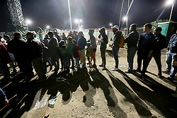 © London News Pictures. Migrants wait to get into the camp close to the Hungarian and Serbian border town of Roszke, Hungary, September 7 2015. The UN's humanitarian agencies are on the verge of bankruptcy and unable to meet the basic needs of millions of people because of the size of the refugee crisis in the Middle East, Africa and Europe, senior figures within the UN have told the media.  Photo credit: Paul Hackett/LNP