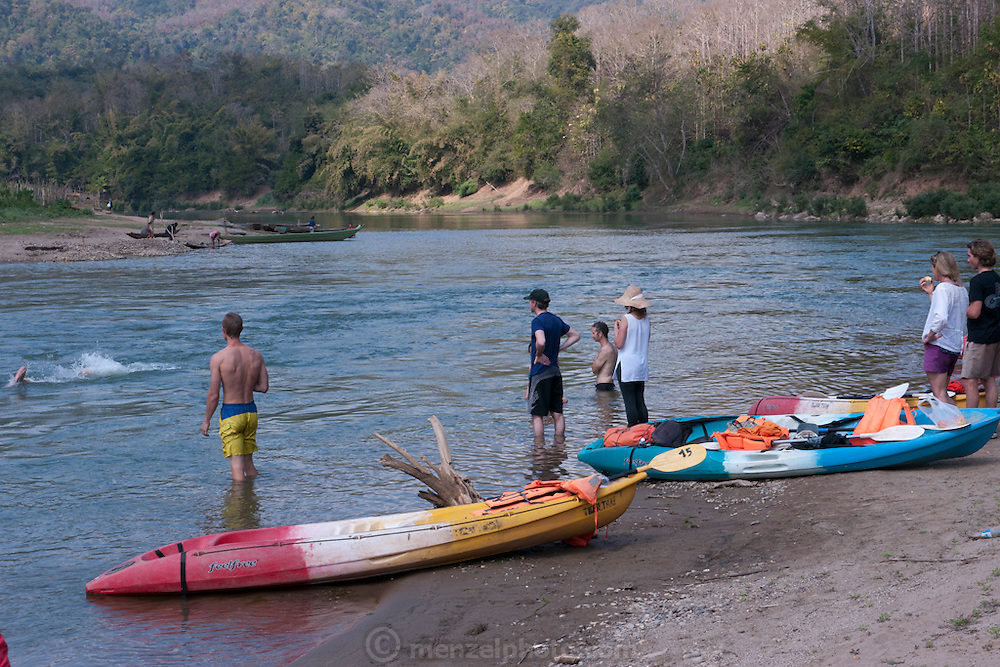 Kayaking on the Nam Khan River near Luang Prabang, Laos.