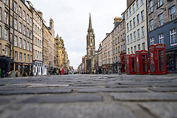 Edinburgh, Scotland, UK. 28 December 2020. Scenes from Edinburgh City Centre as Scotland starts first weekday under the most severe level 4 lockdown with all non-essential businesses closed. Pic; The Royal Mile  is very quiet with very few tourists. Iain Masterton/Alamy Live News
