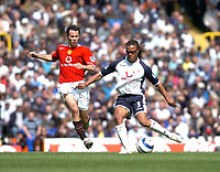 Photo: Leigh Quinnell.<br /> Tottenham Hotspur v Manchester United. The Barclays Premiership. 17/04/2006. Tottenhams Edgar Davids gets the ball away from Man Utds' Ryan Giggs.