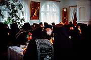 Elders of the Russian Orthodox Church at the Pskov-Pechersky Monastery are obligated to a code of silence while scriptures are read during lunch. Repressed in the 1920s and '30s, when thousands of priests and monks were killed, the Orthodox Church and Kremlin share close ties today. President Vladimir Putin and Patriarch Kirill oppose gay rights and see eye to eye on Russia's muscular foreign policy.  © Steve Raymer / National Geographic Creative