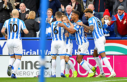 Huddersfield Town's Alex Pritchard celebrates scoring his side's first goal of the game with team mates during the Premier League match at the John Smith's Stadium, Huddersfield.