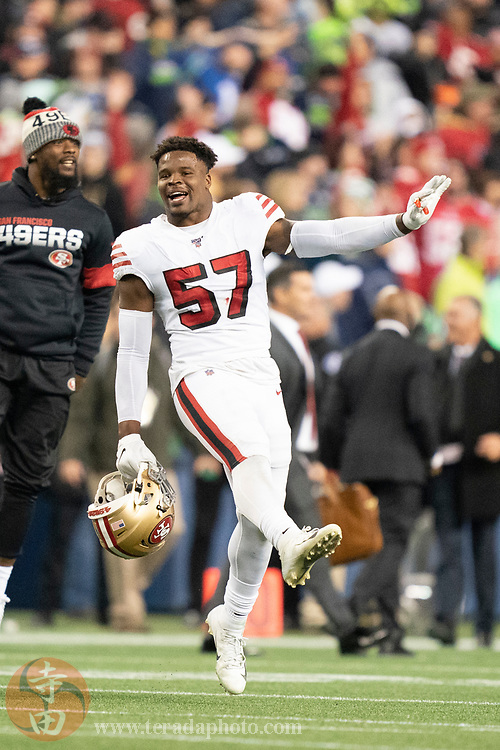 December 29, 2019; Seattle, Washington, USA; San Francisco 49ers linebacker Dre Greenlaw (57) celebrates during the fourth quarter against the Seattle Seahawks at CenturyLink Field.