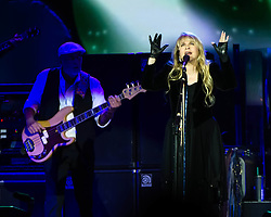 © Licensed to London News Pictures. 24/09/2013. London, UK.   Fleetwood Mac performing live at The O2 Arena.  In this pic - John McVie (left), Stevie Nicks (right). Fleetwood Mac are a British-American rock band formed in 1967 in London consisting of Mick Fleetwood (drums), John McVie (bass), Lindsey Buckingham (guitar/vocals) and Stevie Nicks (vocals).  Photo credit : Richard Isaac/LNP