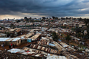 KENYA. Nairobi. Overview shot of the slum Kibera...Kibera is Africa's largest slum and it is located in Nairobi, Kenya. It houses one million people squeezed into less than a square mile. Most people living in Kibera have little or no access to basic necessities, such as electricity, clean water, toilet facility and sewage disposal. The combination of poor nutrition and lack of sanitation accounts for many illnesses and deaths.