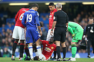 Eric Bailly of Manchester United looks on injured. Premier league match, Chelsea v Manchester Utd at Stamford Bridge in London on Sunday 23rd October 2016.<br /> pic by John Patrick Fletcher, Andrew Orchard sports photography.