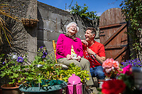 No repro fee<br /> 22-6-2018<br /> **DERMOT BANNON GETS HIS FINGERS GREEN FOR THE BANK OF IRELAND BACKYARD BLITZ**<br /> **450 Bank of Ireland volunteers swap hedge funds for hedge clippers across Dublin, Galway and Cork**<br /> Picture shows Mary Downs, East Wall resident with Celebrity Architect and RTÉ star Dermot Bannon; along with over 450 Bank of Ireland volunteers tackled 200 gardens in Dublin, Cork and Galway today as part of a community initiative with Age Action. Now in its second year, the Bank of Ireland Backyard Blitz matches employees with older members of the community whose gardens are in need of a summer tidy-up and find these jobs hard to tackle by themselves. <br /> One of the gardens that benefited from an expert makeover was the Seán O'Casey Community Centre Garden in East Wall. The Centre provides a space for members of the 5,000-strong community in the area, 70% of which are aged over 65. With Dermot Bannon's design expertise, Bank of Ireland volunteers will refurbish the garden adding a patio area, pergola, beautiful plants and a mural to brighten up the area for all the residents of the community.  <br /> In addition to the Backyard Blitz, Bank of Ireland supports Age Action with volunteering, fundraising and financial support, as well as providing teaching on the basics of the internet and digital world through Tea & Teach sessions. <br /> Pic:Naoise Culhane-no fee