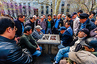 Older Chinese men playing Chinese chess, Columbus Park, Mulberry Street, Chinatown, New York City, New York USA.
