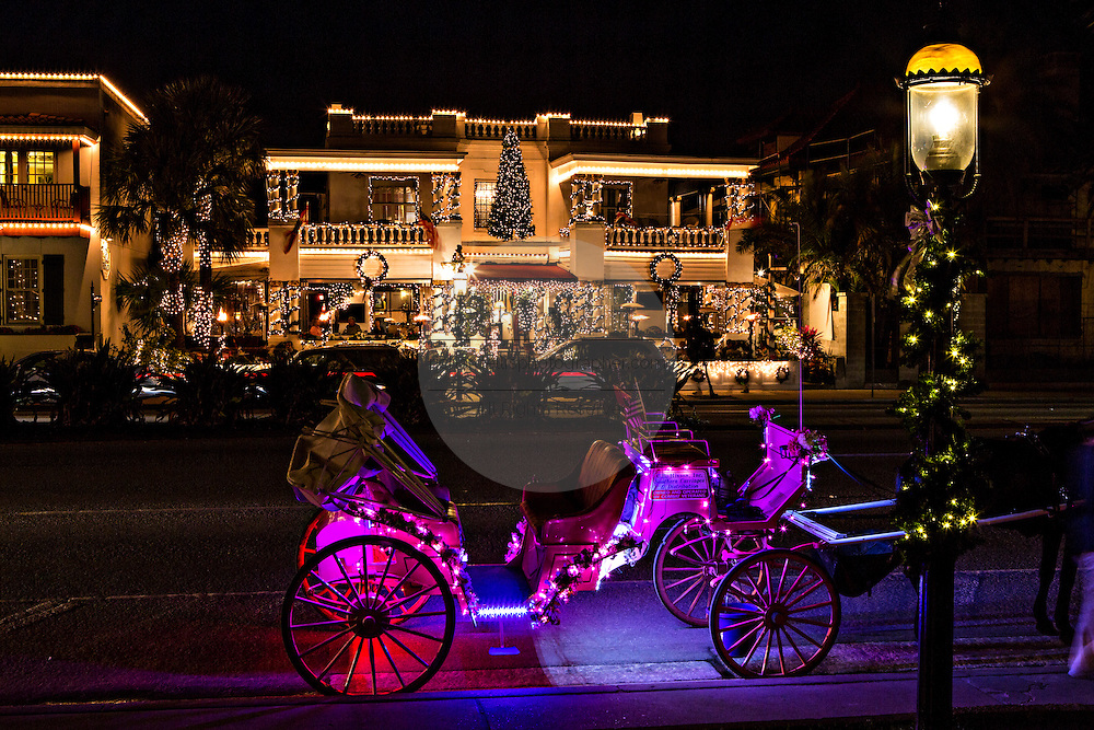 Buildings along Avenida Menendez decorated with Christmas lights in St. Augustine, Florida. The lights are part of the Night of Lights festival.