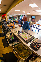 Recreational sales counter, Medicine Man Denver is the single largest legal medical and recreational marijuana dispensary in Denver, Colorado USA. Their 20,000 sq. ft. facility will soon double in size. Radio frequency ID tags and 65 video cameras allow the State of Colorado to track inventory through the growing process and all plant weight is accounted for. Medicine Man won the High Times' Cannabis Cup for best sativa (Jack Herer). 20-30 strains are available for sale daily.