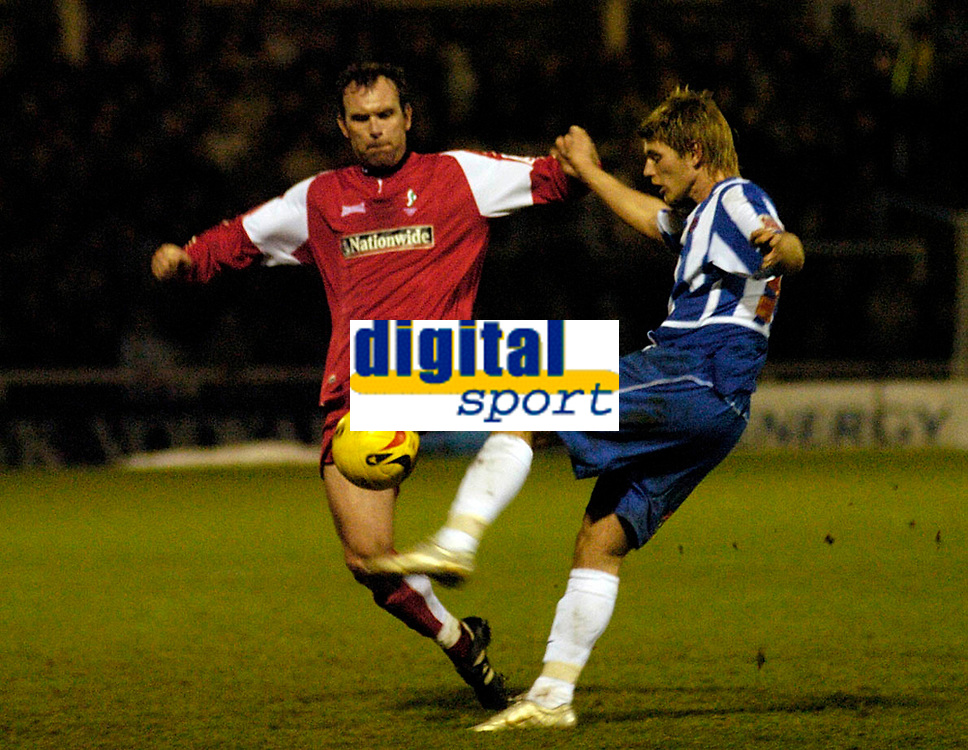 Photo: Leigh Quinnell.<br /> Hartlepool United v Swindon Town. Coca Cola League 1.<br /> 02/01/2006. Swindons Steve Jenkins clashes with Hartlepools Michael Maidens.