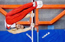 Christian Baumann of Switzerland competes in the Horizontal bar during Final day 2 of Artistic Gymnastics World Cup Ljubljana, on April 27, 2013, in Hala Tivoli, Ljubljana, Slovenia. (Photo By Vid Ponikvar / Sportida.com)
