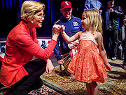 25 APRIL 2019 - CEDAR RAPIDS, IOWA: US Sen. ELIZABETH WARREN (D MA) shakes pinkies with EMMELINE WARBASSE, 3 years old, from Cedar Rapids, after Warren's campaign speech at the Linn Phoenix Club in Cedar Rapids. The Linn Phoenix Club is an organization that promotes Democratic candidates in Linn County, Iowa. Sen. Warren is campaigning in eastern Iowa Thursday night and Friday to promote her bid to the Democratic candidate for the US Presidency. Iowa traditionally hosts the the first selection event of the presidential election cycle. The Iowa Caucuses will be on Feb. 3, 2020.           PHOTO BY JACK KURTZ